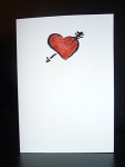 Handmade Valentine's Day card, plain white, teenage love heart embossed in black and red